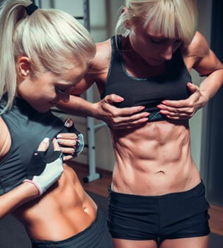 Women checking out abs
